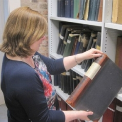 A volunteer in the archives at Manchester Art Gallery