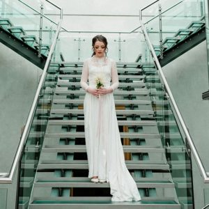 Bride on atrium steps at Manchester Art Gallery